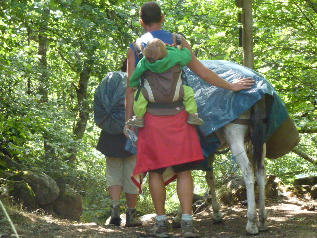 Family with over laden donkey who didn't want to go down the steep path