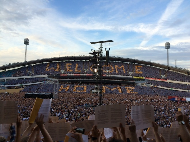 """One side said """"Welcome Home"""" and my side said """"Bruce and E Street"""". The people in front of me are holding up the papers to make the sign."""